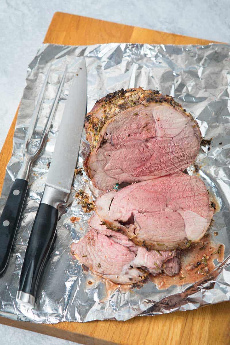 Sliced lamb on tin foil