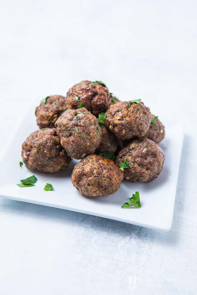 A plate full of browned air fryer meatballs