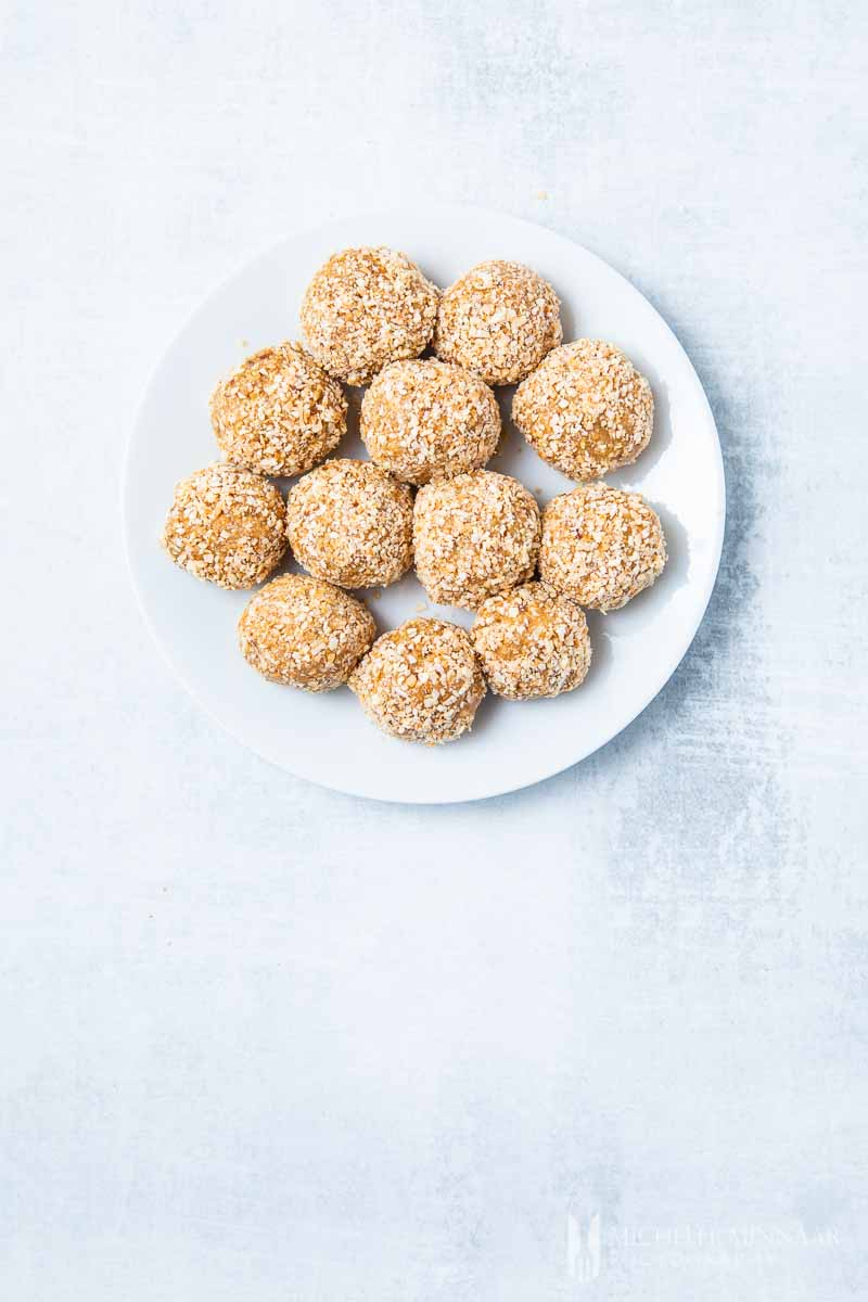 A plate of peanut butter coconut balls