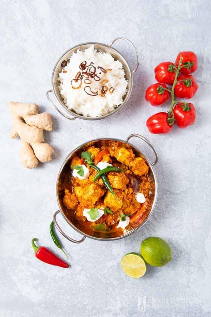A bowl of tawa paneer tikka and white rice, fresh ginger
